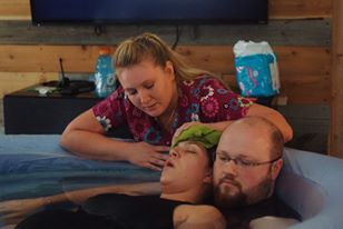 water birth with Comforts of Home Midwifery